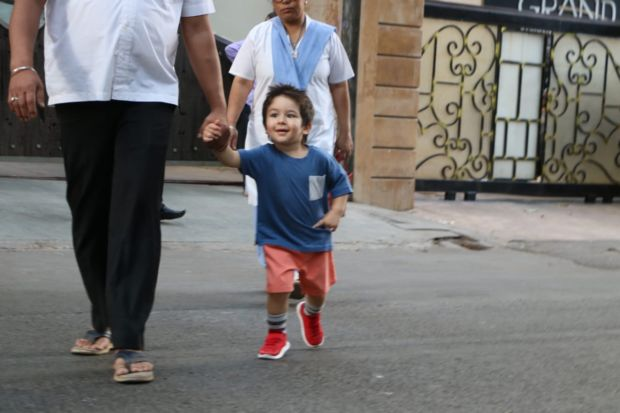 Taimur Ali Khan Swaggers Down The Road With A Sporty Spike And Red Kicks